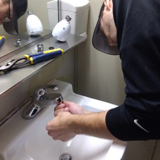 Guy installing faucet aerator
